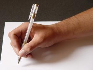 szerződés írása - tollat tartó kéz